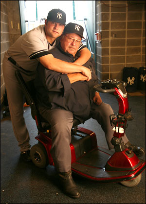 Joba poses with his dad Harlan, an endearing scene that has occurred throughout his Yankees' career (Photo: SI)