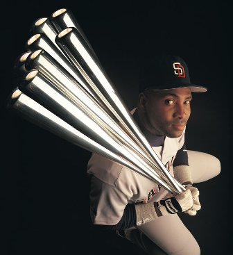 Tony Gwynn shows off his eight batting title trophies. (Photo: SI)