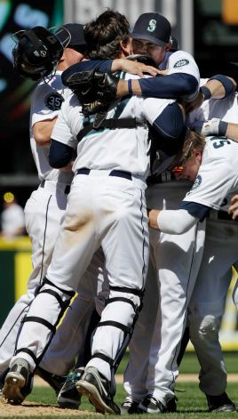 Like so many batterymates before them, Hernandez and Jaso embrace after the last out of the Mariners perfect game victory over the Rays. (Photo: AP)